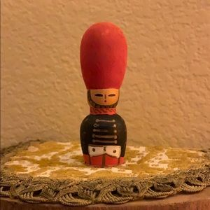 Wooden soldier wearing BIG red hat vintage decor